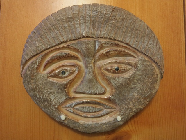 Mask carved in whale bone by artist from village of Shishmaref, Alaska