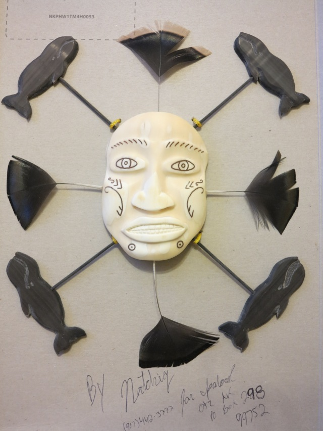Spirit Mask by Kotzebue artist (fossil ivory). Represents the fragile balance between human needs and what nature provides and Alaska Natives respect for nature.