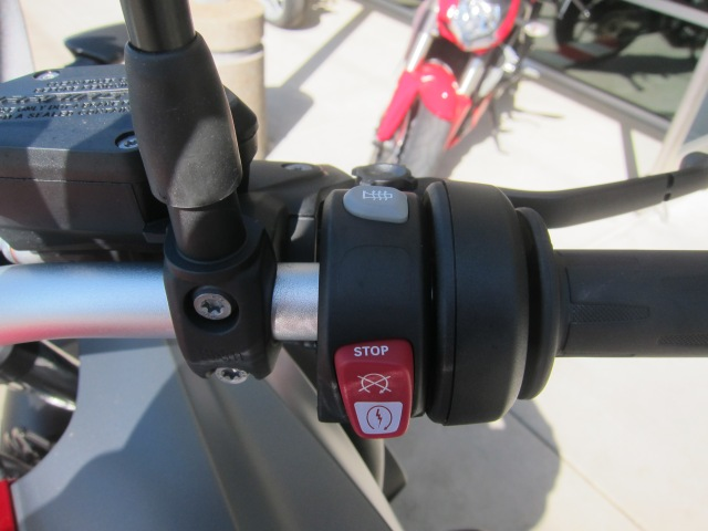 Empty spot between heat grips and ignition/engine cut off button - probably a button on bikes with more options