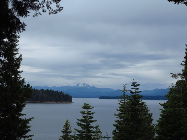 Lake Almanor, Lassen Peak on the background, dark skies announcing rain