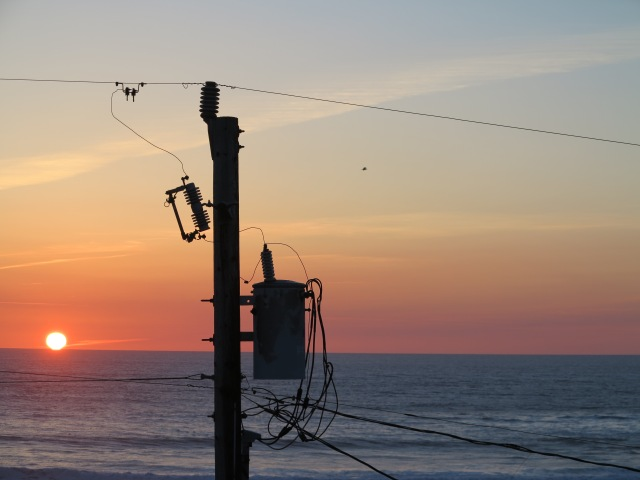 The sunset and the electric post