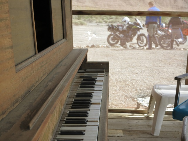 The piano in the porch of the trading post, Ballarat, CA.