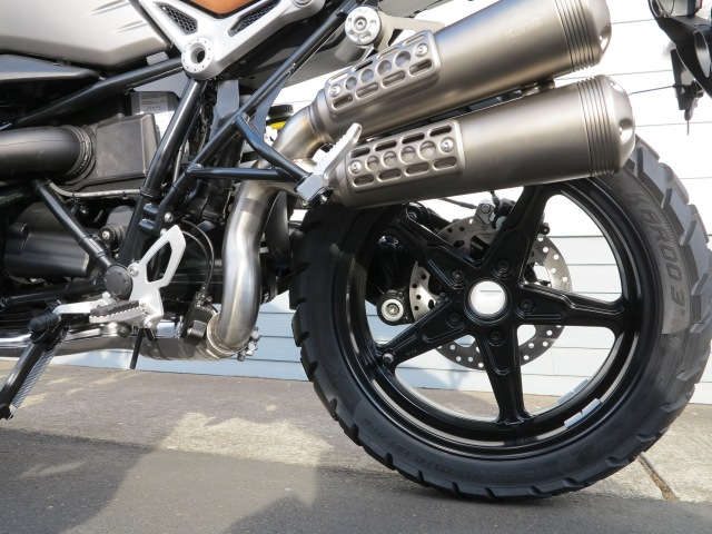 "Footpegs are positioned slightly lower than on the roadster. The Akrapovic exhaust is ""scramblerized"""