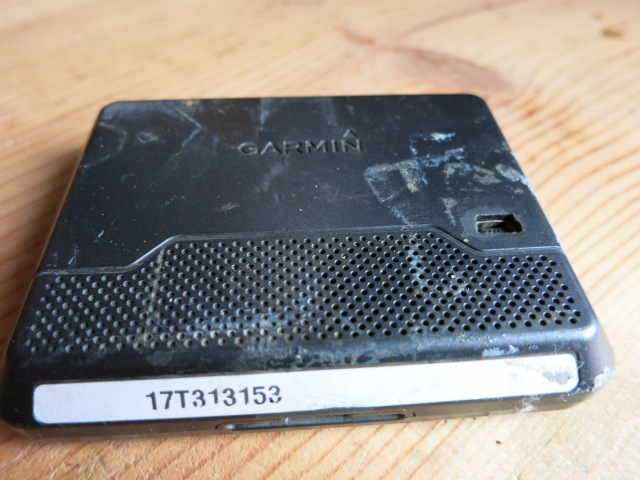 The back of the Nuvi 260 after tape was removed after its retirement. The same Gorilla tape lasted all years of use!